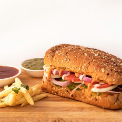 A sandwich and fries on a table Description automatically generated with low confidence